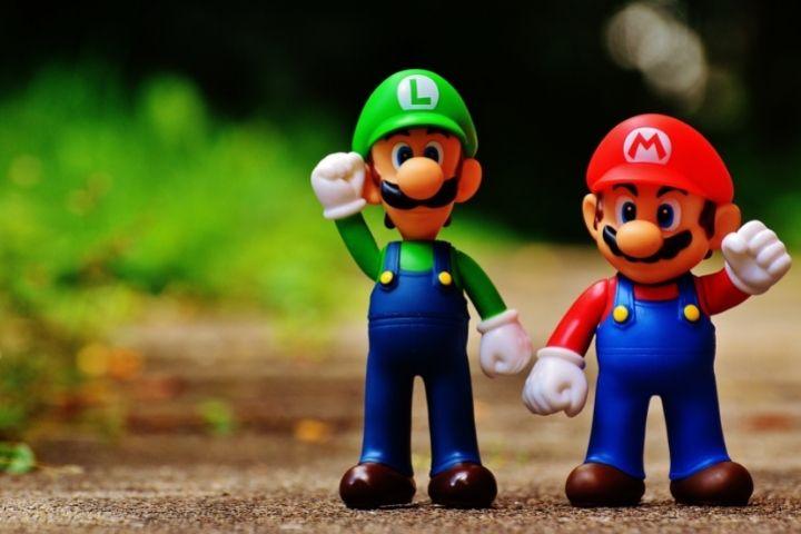 """Robot plays """"Super Mario Bros."""" With a Controller"""